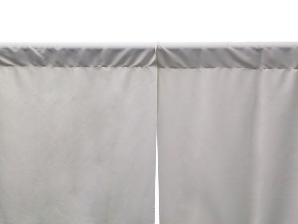 A closeup image of flat pipe and drape curtains