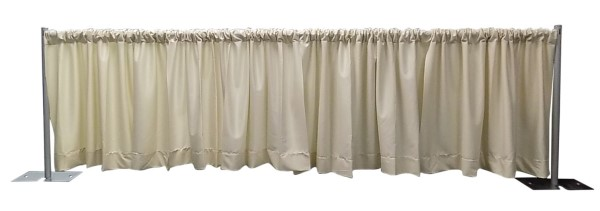 Photo of a pipe and drape display with beautifully pleated drapery panels