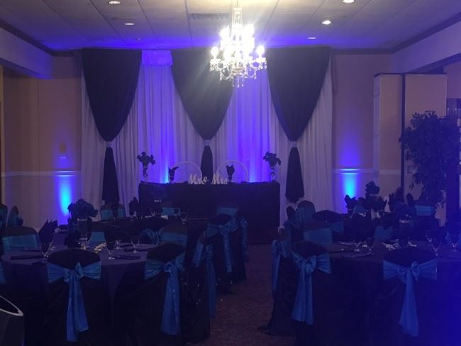 Pipe and drape backdrop with a dramatic look