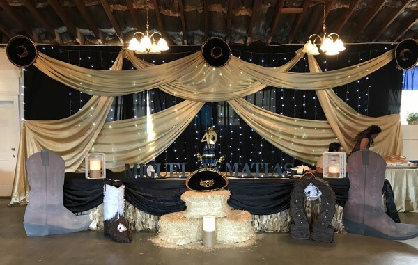 Pipe and Drape Backdrop with Swags and Lights