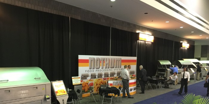 A picture of a pipe and drape trade show backdrop in use.