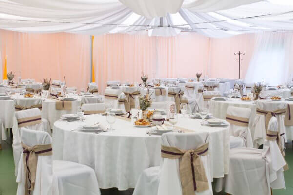 Ceiling draping kits and fabric ceiling swags make any wedding venue look like something out of a fairytale.