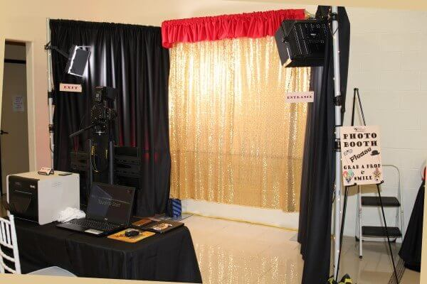 A photo booth is a great way for your guests to remember your wedding.